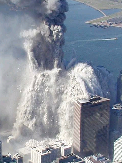 Tower 1 falling on WTC 7